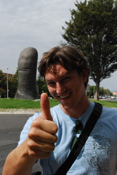 Flashpacking Curtis with the giant thumb statue in Marseille