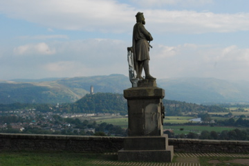 Robert the Bruce with the Wallace Monument in the distance