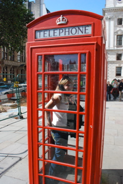 Flashpacking Wife in a London phone booth
