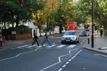Flashpackers walking across Abbey Road