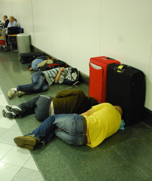 Travelers sleeping at Gatwick