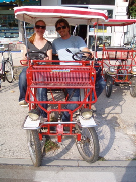 Flashpackers on double bike in Lido